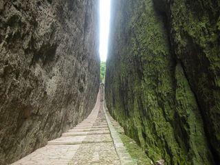 Linear road between cliffs