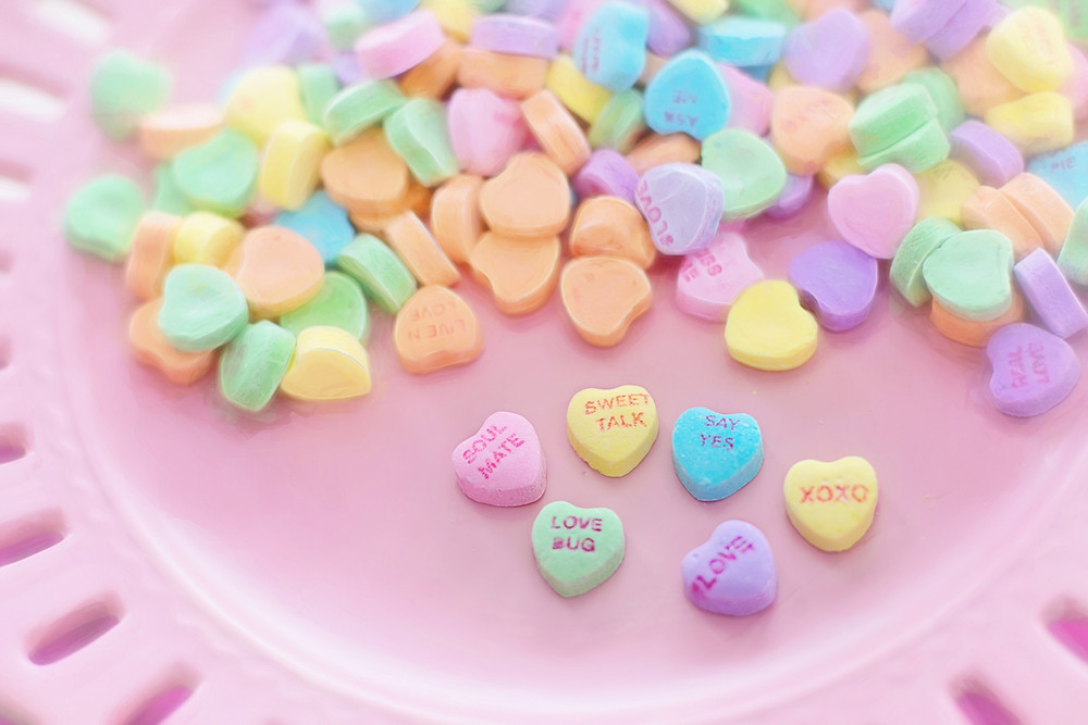 Valentine's Day conversation hearts on a pink plate