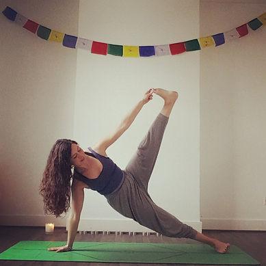 Woman in side plank balance