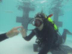 Scuba diver practicing in a pool