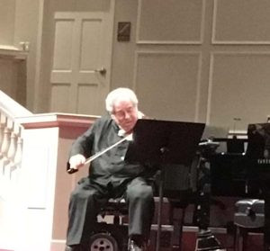 Photography of Itzack Perlman in concert