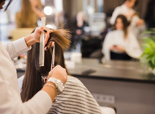 brunette-woman-getting-her-hair-cut_23-2