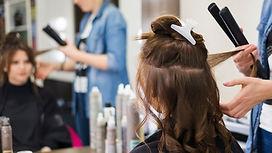brunette-girl-getting-her-hair-done_23-2