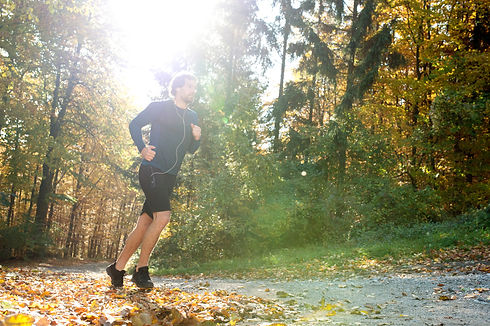 young-handsome-runner-outside-in-sunny-a