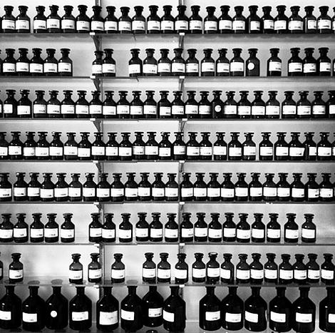 saint bottles on shelves.png