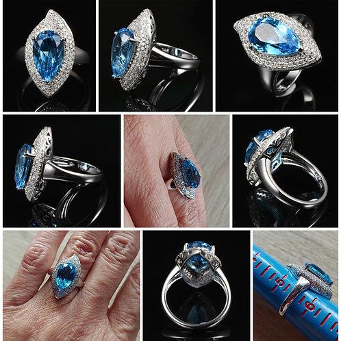 14kt White Gold Blue Topaz and Diamond Ring