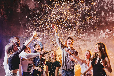 friends-having-fun-falling-confetti_23-2