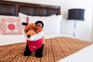 A Fox stuffed animal on bed