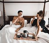 Couple in Deluxe room enjoying breakfast