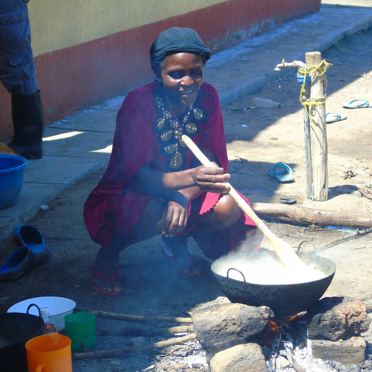 Woman cooks for her family in Ayweyo