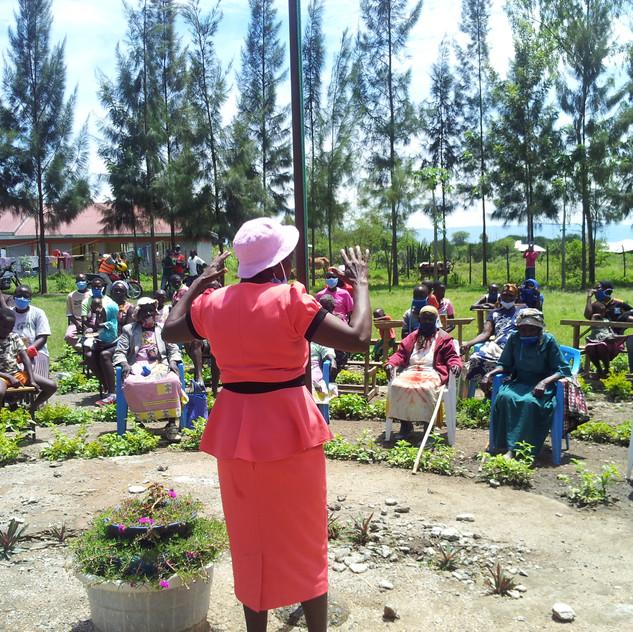 Ruth talking to families in Ayweyo