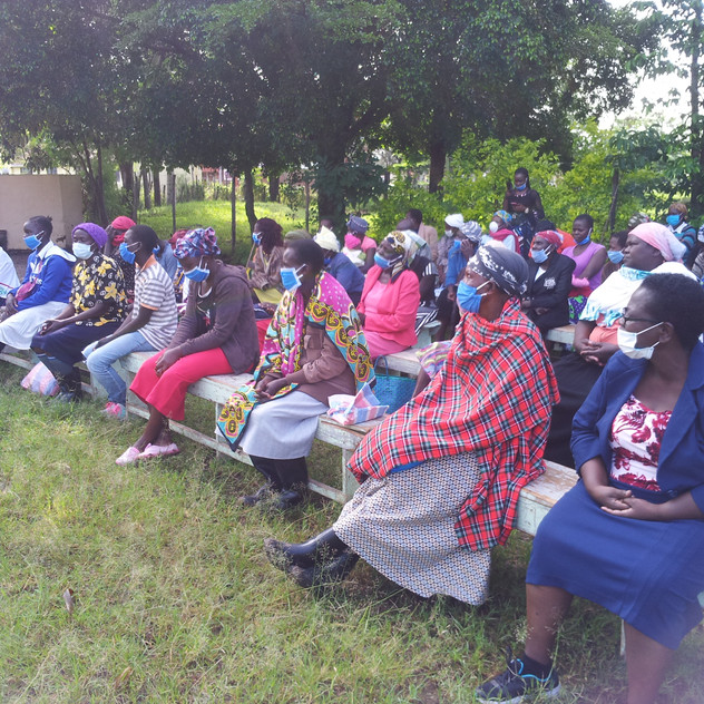 Jenipher seated with families in Ebeneze