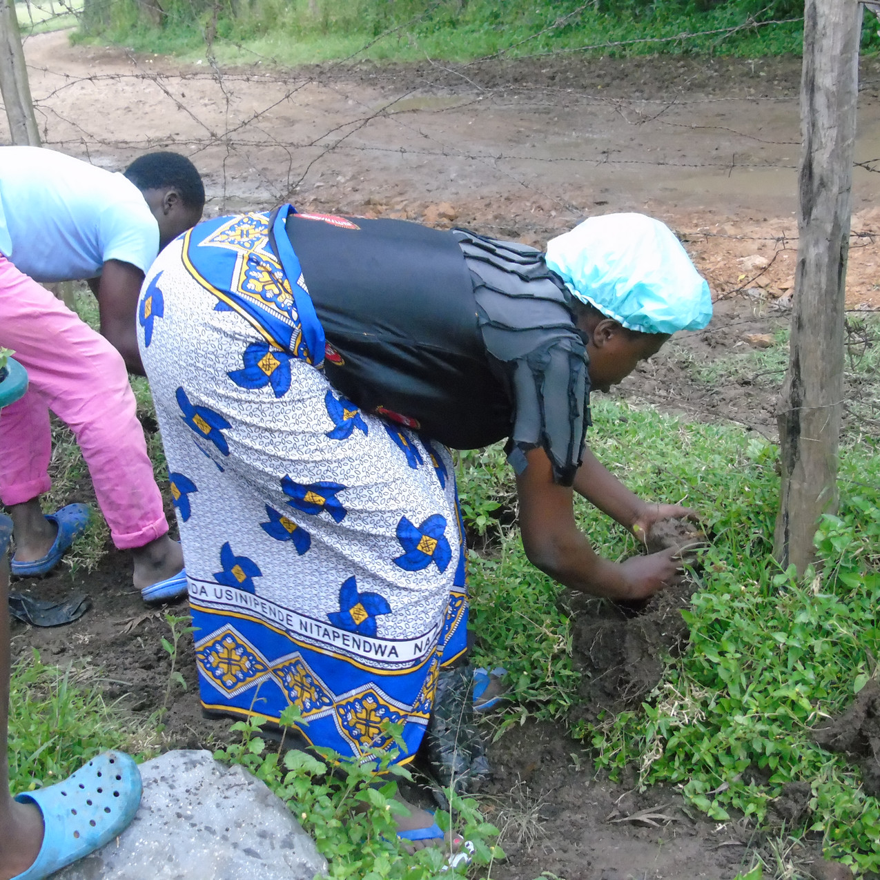 Interns and children Planting and wateri