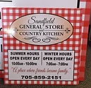 coroplast sign showing hours sandfield general store