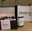 wikwemikong tradeshow coyote popup display system carry case podium table throw and runner
