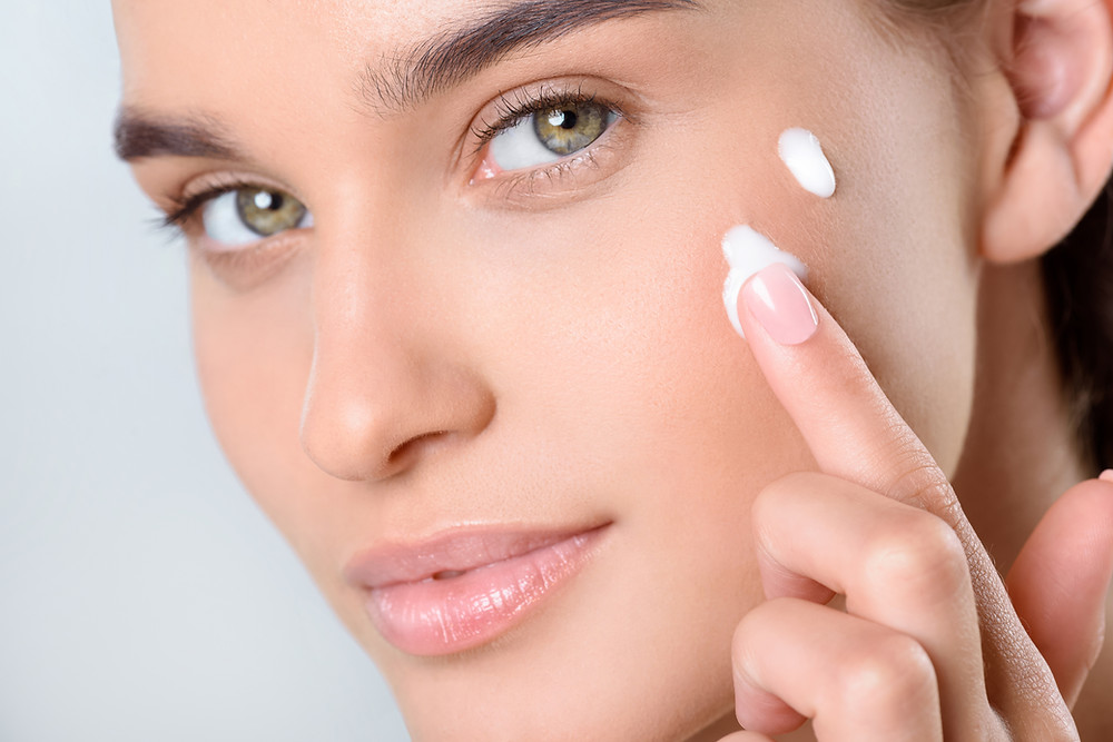 Beautiful-model-applying-skin-care-creams-best-beauty-products-to-buy for 2019.: ultimate-makeup-and-skin-care-must-haves
