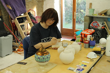 applying gold lustre to pots