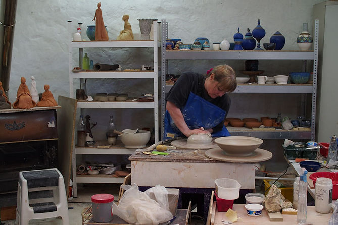 throwing a large bowl on the potters wheel