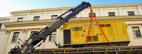 Crane lifting new generator set and offloading