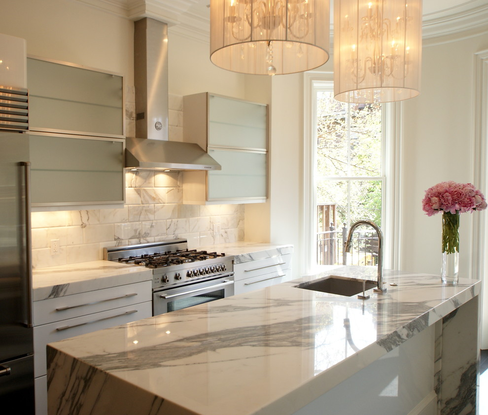 cost-of-marble-countertops-Kitchen-Transitional-with-floral-arrangement-island-lighting