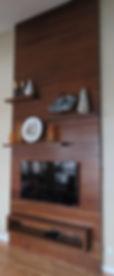 Custom wood panel wall mounted TV