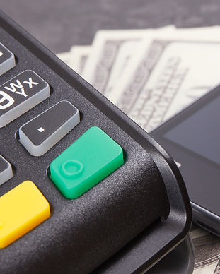 payment-terminal-money-and-smartphone-wi