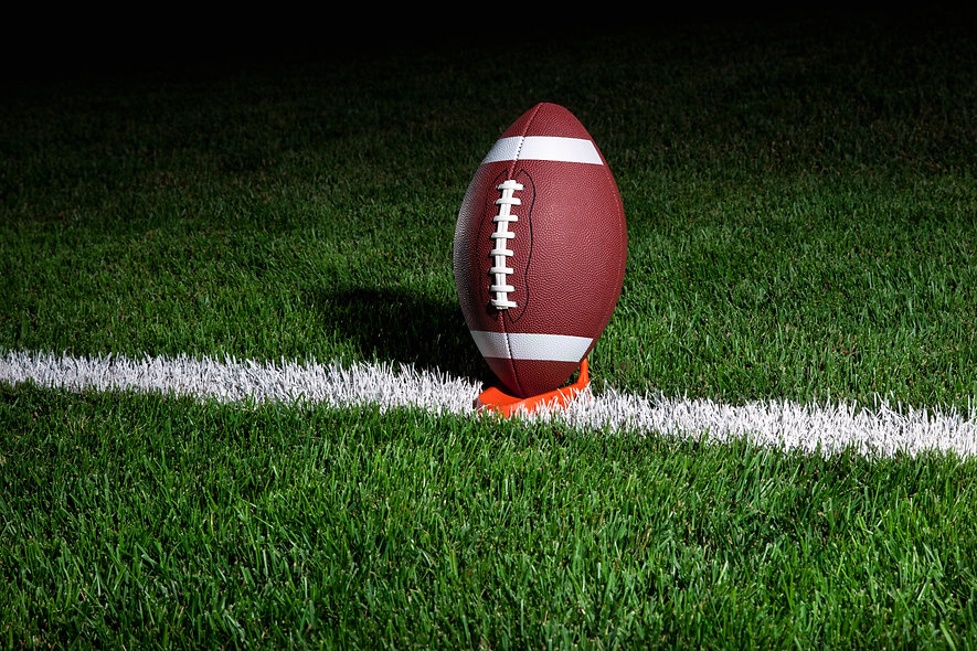 college-football-on-a-tee-at-night-JF35Q