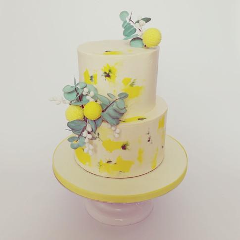 Yellow and green buttercream wedding cake