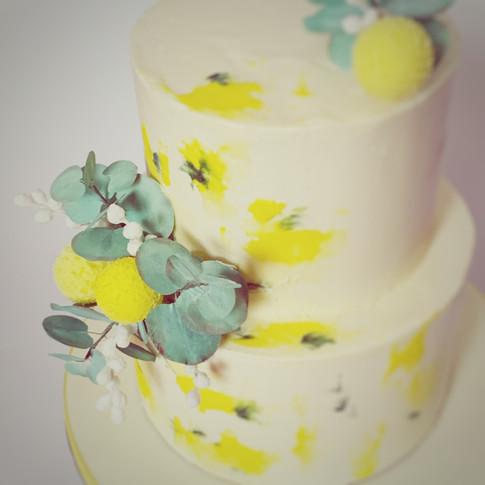 Close up of yellow buttercream wedding cake