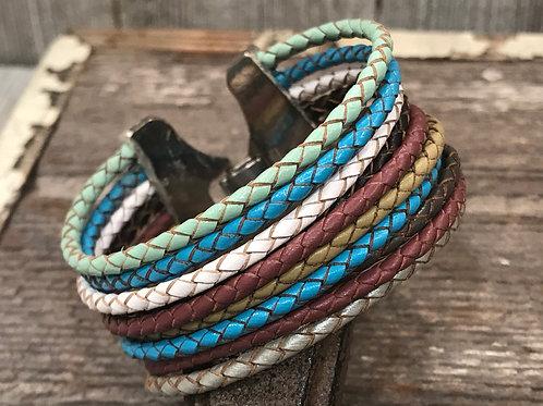 Multi color braided strand cuff bracelet.