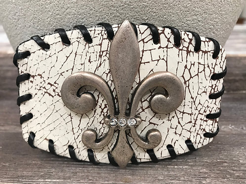 White distressed leather buckle with  silver fleur di lis