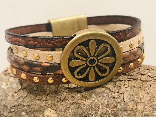 Leather, snakeskin, microsuede cuff bracelet.