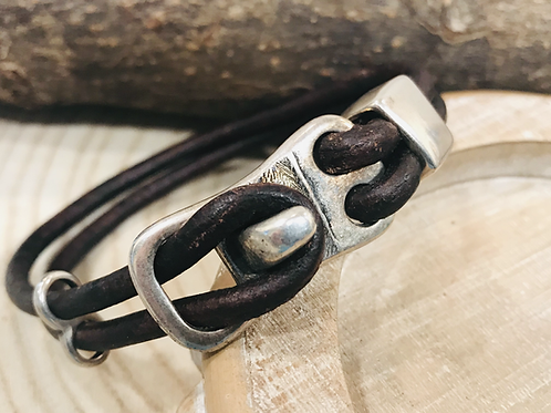 Silver toggle bracelet with round leather cord.