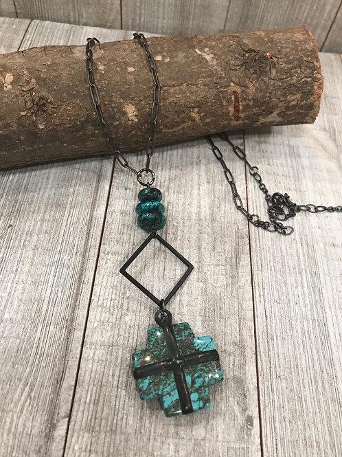 Turquoise matrix cross pendant w/diamond shape connector