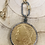 Thumbnail: Black Bezeled Coin Necklace with Carabiner Clasp