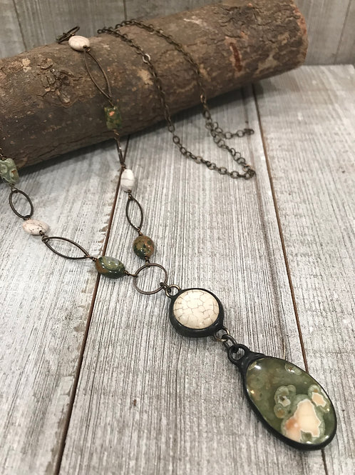 Rhyolite pendant drop with magnesite connector