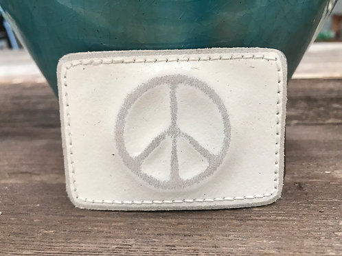 White leather peace sign buckle