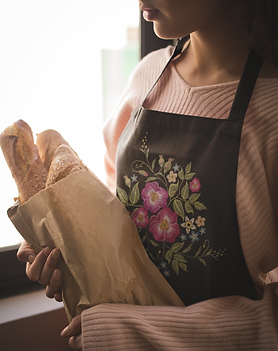 apron-mockup-featuring-a-girl-holding-a-