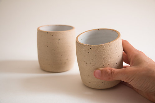 nude & white flecked coffee cup