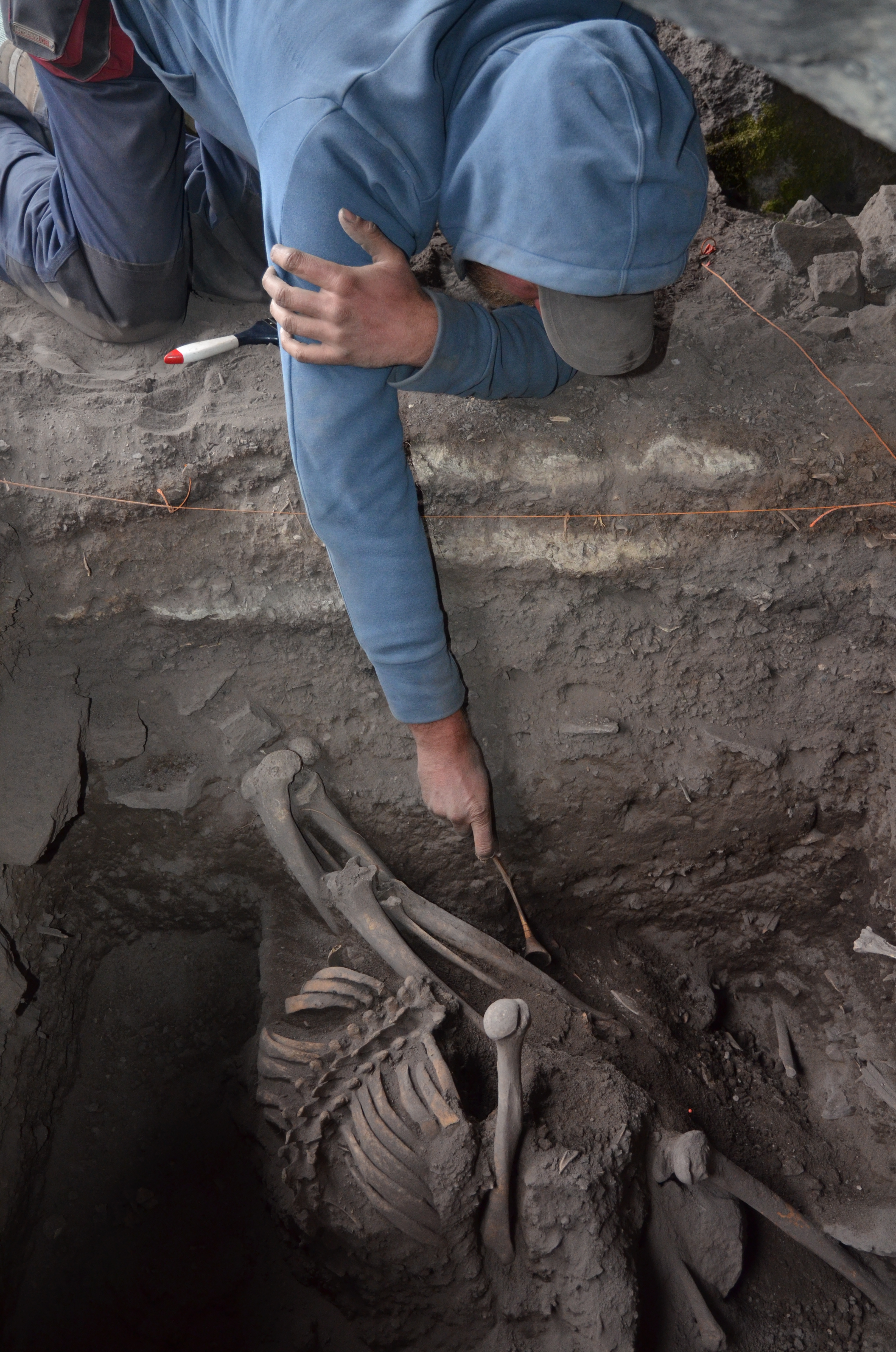 Miche Excavating Human Remains