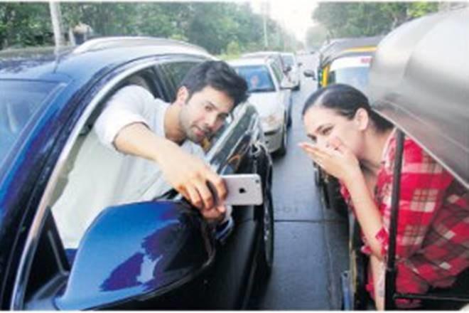 Varun Dhawan taking selfie on the road.