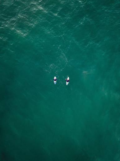 Friends Surfing