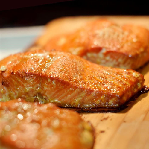 Garlic Crusted Salmon  Family Meal. Served with 2 Sides and Salad.