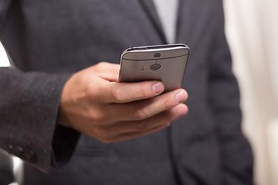 businessman holding cellphone