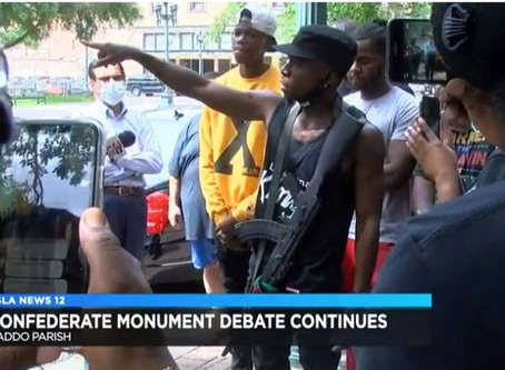 ARMED BLACK MEN IN LOUISIANA SHOW UP AT COURTHOUSE TO COUNTER ARMED WHITE SUPPORTERS OF A CONFEDERAT