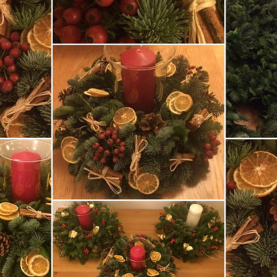 Festive Table Centre with Orange, Cinnamon, Pine Cones and Holly Berries with Candle
