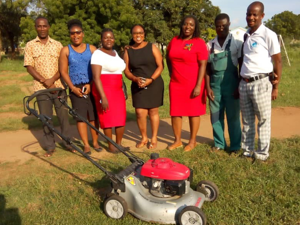 Some Staff of Hope Training Institute with Donated Lawnmower from Hope Training Institute Campus Church