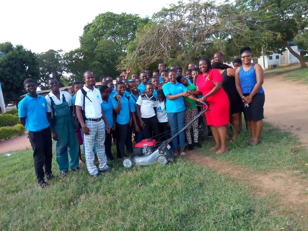 Araba Hammond Receives Lawnmower from Hope Training Institute Campus Church