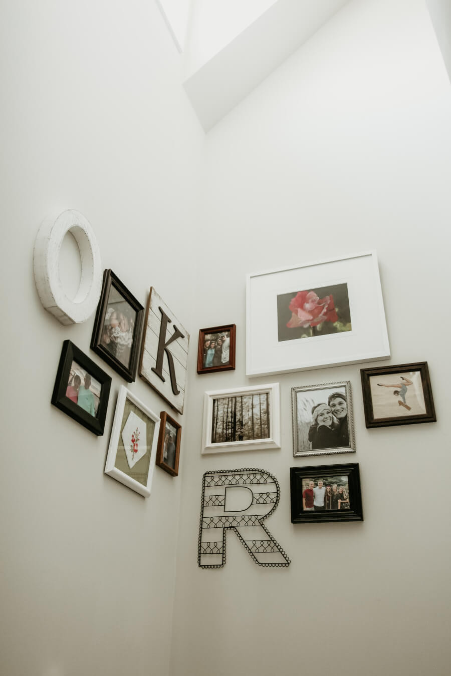 A gallery wall with an assortment of photo frames