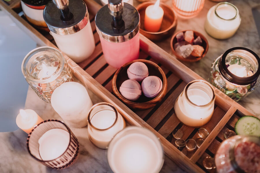 Self-care products surrounded by candles